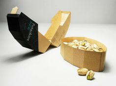 Package shape echoes shape of nut and cracking open action. Biodegradable materials, elegant shape