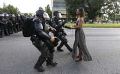 A demonstrator protesting the shooting death of Alton Sterling is detained by law enforcement near the headquarters of the Baton Rouge Police Department in Baton Rouge, Louisiana, U.S. July 9, 2016. Black Lives Matter: The Baton Rouge photo hailed as 'legendary'