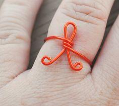 Here's the orange one! Adjustable Wire Wrapped Ring Orange Awareness Ribbon Luekemia and Multiple Sclerosis. $10.00, via Etsy.