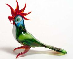 Glass Parrot Hand-Blown  Figurine by GlassZooShop on Etsy https://www.etsy.com/listing/218964010/glass-parrot-hand-blown-figurine