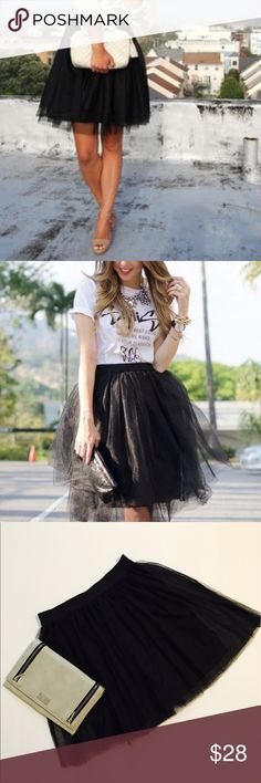Black Tulle skirt Short black tulle skirt. NWT. Elastic waist. Super cute!!  Wear now or in winter with tights. 13.5 inch waist. 18.5 inch length. LC Lauren Conrad Skirts