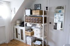 I've pinned this 6 X 2 card catalog from Songbirdblog before, but now the space around it is nicely filled up, so it was worth pinning again. At the source, many other pictures of Songbird's craft room and a few other views of the card catalog.