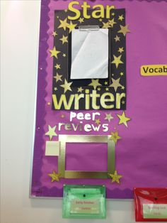 Star writer display. I attached a clipboard to backing paper to change the writing easily. Added a box and post its for peer reviewing.