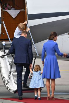 Get a move on! Princess Charlotte was eager to get going and board the plane as her mother...