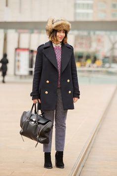 Stylecaster's Perri Samotin's military coat and furry cap.