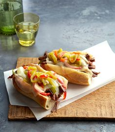 Philly-Style Pulled Beef Sandwiches: We slimmed down these cheesesteak subs by 386 calories each by discarding all the fat when shredding the meat.