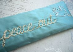 peace out eye pillow in silk and lavender, hand embroidered by Dolce Dreams