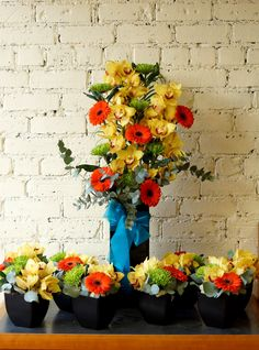 Here are a few images of beautiful vibrant arrangements we made for a corporate event this evening, the flowers used were yellow cymbidium orchids, orange gerbera, green blloms and eucalyptus foliage. The customer rang us on delivery to tell us she was very pleased with them...always good to hear the customer is happy! :) #reidsflorists #happycustomer #vibrantflowers #corporateflowers
