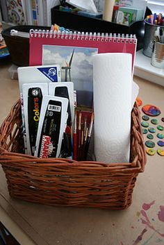 Watercolor Basket.   I moved our watercolors to a basket   so the girls have everything they need whenever they want to paint. I included two tablets of watercolor paper, a small roll of paper towels, paints, brushes, a glass jar (for water), a small and extra fine tip sharpie, a sharpened pencil   and some water-soluble watercolor crayons and pencils.