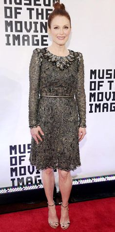 Julianne Moore went for gold at the Museum of the Moving Image Gala in an incredibly rich Chanel Couture frock with an embellished neckline, styling it with a flirty topknot and delicate gold sandals to match