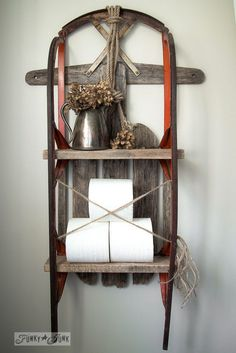 Wood and red snow sleigh toilet paper shelf with dried hydrangeas on FunkyJunkInteriors.net