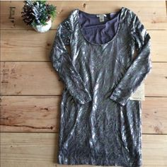 Beautiful Sequined Dress Never been worn! This is a body hugging dress, super sexy and classy! Great for New Years  it's a purple/gray color with silver sequins. All sequins are in tact. Arden B Dresses Mini