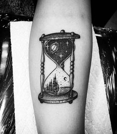 On this tattoo is an interesting combination of old and modern elements. Old elements represents the hourglass and the candle, and new one bulb in the lower bowl.