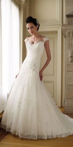 Gorgeous wedding dress my love , this highlight of this strapless gown is the ruffled organza sk