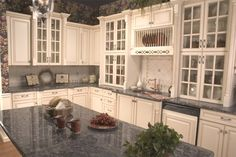 Love the look of furniture in kitchen cabinets. by ester