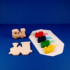Train Party Favors - Deluxe Gift Package - Wood Toy Train - Train Shaped Crayons - Wooden Train Puzzle - Great for Kid and Toddler Partys. $7.50, via Etsy.