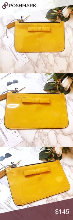 """Auth w tag Marni yellow bow leather pouch $295 Brand new with price tag Marni patent leather pouch with bow accent on front. Yellow sold color, made in Italy. Size is 7.5"""" X 5"""" Marni Bags Clutches & Wristlets"""