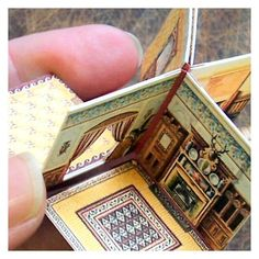how to make a folding dolls house: http://openhouseminiatures.wordpress.com/2013/03/01/how-to-make-a-folding-dolls-house/