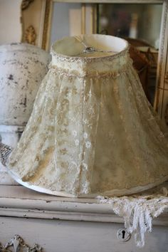 Gorgeous lamp shade with vintage lace.