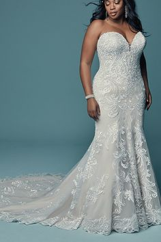Luanne by Maggie Sottero features embroidered lace motifs in a soft fit-and-flare silhouette. This ultra-flattering style is perfect for a variety of vintage-inspired venues. Plus Size Brides, Plus Size Gowns, Plus Size Wedding, Bridal Gowns, Wedding Gowns, Inexpensive Bridesmaid Dresses, Maggie Sottero Wedding Dresses, Fit And Flare Wedding Dress, Designer Wedding Dresses