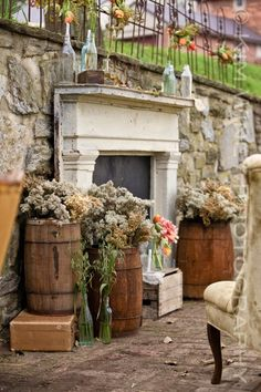Val, ignore the flowers but I have 2 small barrels like this & I also love the bottles on the mantel. :) I like the crates & such stacked around the bottom of the mantel too