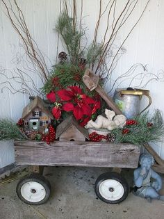 """A vintage wagon becomes the stage for your own holiday village! To start, fill the wagon with little birdhouses. Add in evergreen branches to fill in the remaining space for a """"forest"""" surrounding the town. Extra flowers and ornaments are key to punch up that holiday look.<br /><br />Photo: <a href=""""http://www.hometalk.com/2701702/outdoor-decor"""" target=""""_blank"""">Hometalk</a>"""