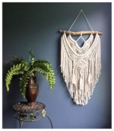 This stunning, hygge-inspired macramé wall hanging tapestry will add instant texture and charm to any space in your home. Woven macramé hangings are incredibly versatile, and can easily transform any room into a modern, yet ethereal sanctuary. When deciding where to hang it, allow