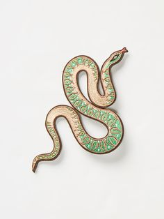 Serpent Patch | Add a wild touch to your favorite jacket or pair of jeans with this iron-on patch featuring a serpent graphic. Designed by Lisa Vanin.