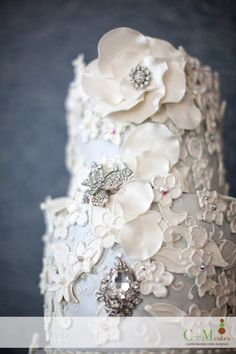 Exquisite Lace Detail on this White Wedding Cake