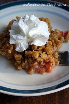 Warm rhubarb crisp with a dollop of whipped cream....heaven on a plate.