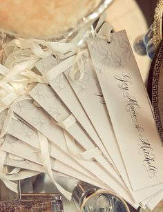 Idea for wedding program.  Could make these, print on heavy paper, 1 page per program, cut with paper cutter, hole punch, tie ribbon