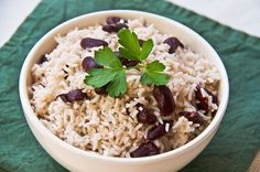 Traditional Jamaican Rice and Peas is a side dish made with white rice, kidney beans, coconut milk, herbs and spices. Get the recipe at http://tastetheislandstv.com/traditional-jamaican-rice-and-peas/. #jamaican #rice #peas #coconutmilk #vegetarian #side #jamaicanfood #islands #foodie #paradise #nomnom #food #recipes #caribbeanfood #tastetheisland