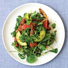 A refreshing salad of chili-rubbed crab meat, creamy avocado, tart grapefruit, and herbs.