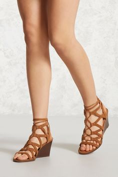 81a89bc44d A pair of faux suede heels featuring a braided strappy design, lace-up front