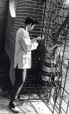 Elvis signing an autograph at his newly installed wrought-iron Graceland front gates on Friday, 26 April 1957. He had the gates installed by the Tennessee Fabricating Company on Monday, 22 April 1957.  (Thnx to Louis Linotte who shared this photo with the ELVIS PICTURES group on fb.)