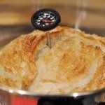 You can be extra-sure that the bread is done when an instant-read thermometer inserted in the top or side reads 210°F.