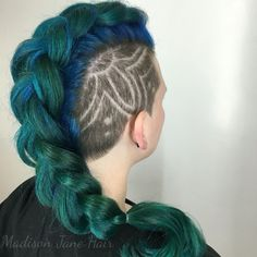 Mermaid Mohawk! Teal, blue and green gradients. Love seeing so many women rocking shaved heads. Her hair is still so thick and luscious even after shaving 2/3 of it off! Fun flower design on the side. Check out @madisonjanehair on Instagram for more photos.