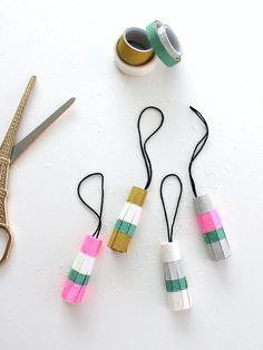 Happy hump day, and first day of November!I originally intended for today's post to be a holiday project, but the reality is that these pretty glitter washi ta Tassel Keychain, Diy Keychain, Christmas Gift Wrapping, Christmas Bells, Diy Tassel, Tassels, Paper Trimmer, How To Make Scrapbook, Paper Ornaments