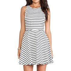 "Striped dress Black and white striped dress with adorable back cut out • lined skirt• self and lining 100% cotton • side zipper closure • bust 18"" across, waist 14"" across, 35"" from shoulder to seam BB Dakota Dresses"
