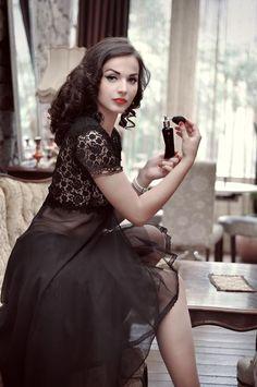 Idda van Munster with bottle of Dita Von Teese's perfume
