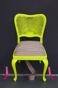 Spray paint some thrift store finds neon colors... but I'd rather see a black or white cushion. An easier route may be spray paint old fold up metal chairs.