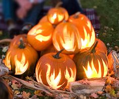 We love this bonfire inspired pumpkin stack! Create your own with flame-design pumpkin stencils and use Pumpkin Masters LED Pumpkin Lights to create a soft, natural glow. http://www.pumpkinmasters.com/lighting.asp (via Better Homes and Gardens)