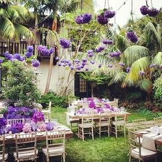 Wedded bliss under radiant orchids. #coloroftheyear