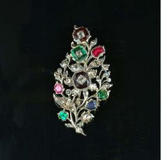 A 19th century diamond and gem-set brooch,
