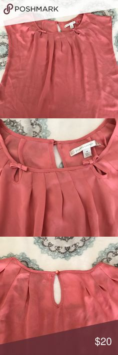 Charming Charlie blouse Charming Charlie blouse size medium. Super cute, feminine and dressy. Please check all pictures for the adorable little bows and keyhole opening on the back. Feel free to bundle and save! 🌸 Charming Charlie Tops Blouses