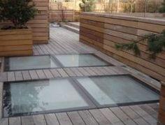 Dalles de sol en double vitrage pour une terrasse