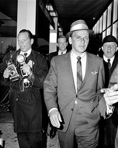 Frank Sinatra at JFK Airport as he returns from Europe.