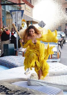 Ruffle up a storm life Beyonce in a mustard yellow dress by Roberto Cavalli #DailyMail Click 'Visit' to buy now