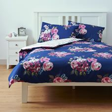 A beautiful vintage-inspired duvet set in a navy and pink floral posy design with slim stripe detail on the reverse. Made from an easy care polyester  and cotton mix. <br><br>This set contains one double duvet cover and two housewife style pillow cases. 52 per cent polyester, 48 percent cotton.  Machine washable. Keep away from fire. Always read instructions.