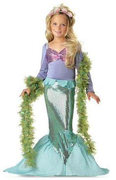 Your little one will be making splashes in this mermaid costume. Features a mermaid dress with purple top, pink sequin bikini top, turquoise sequin tail and a seashell headband. Boa not included. Avai